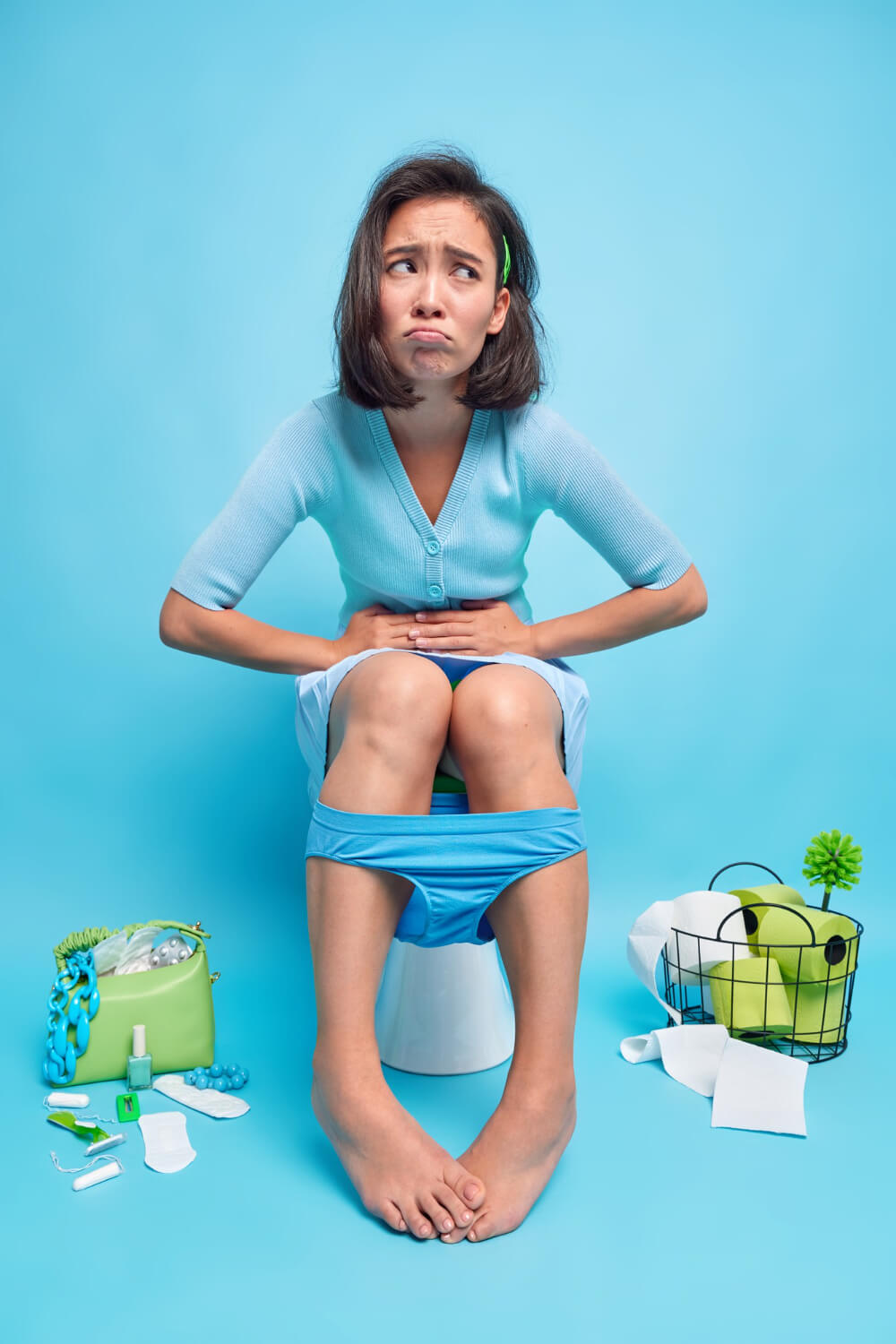 indoor-shot-displeased-asian-woman-suffers-from-stomachache-indigestion-diarrhea-poses-poses-toilet-bowl-feels-unwell-because-abdominal-pain-wears-panties-down-legs
