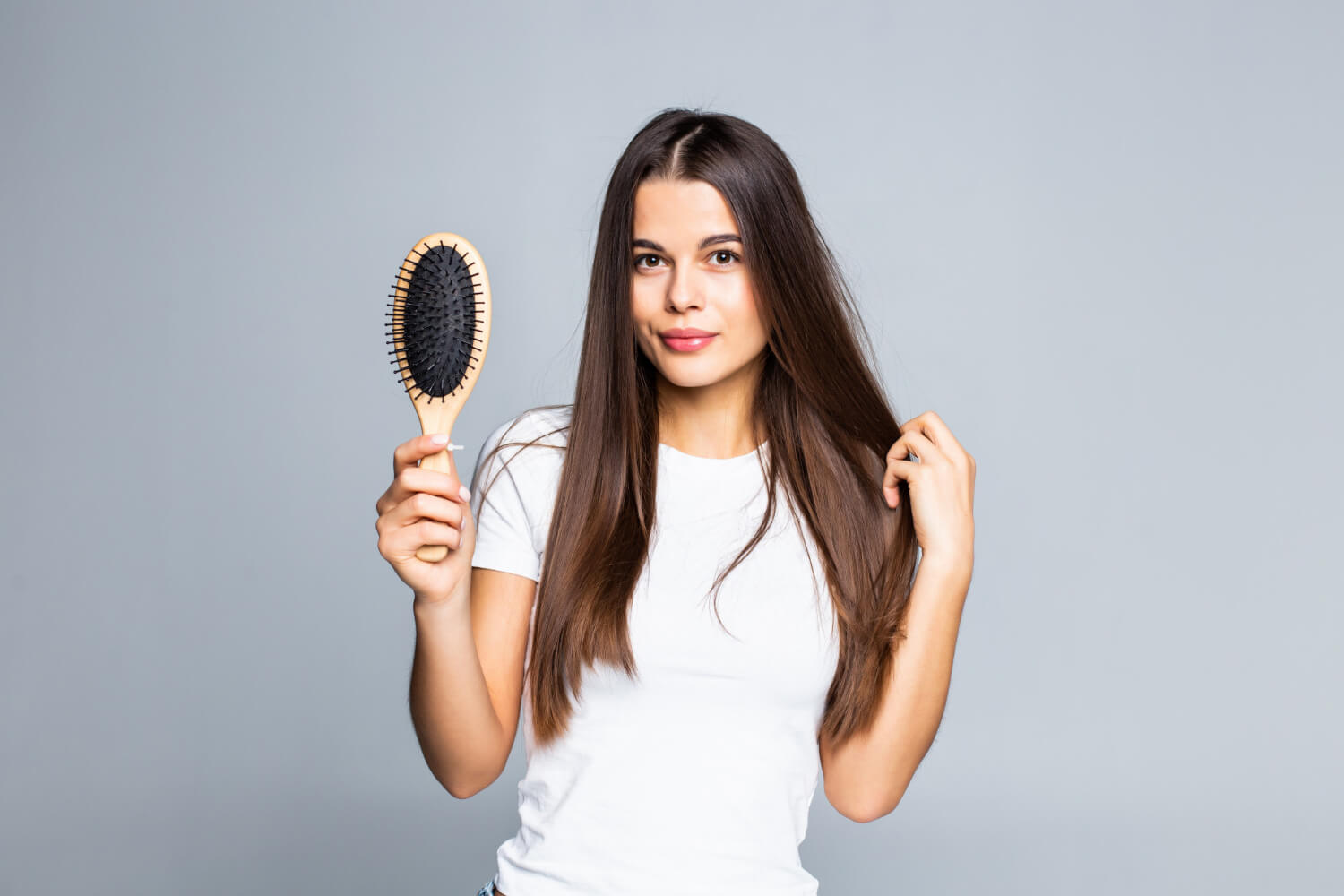 woman-combing-her-hair-isolated-white
