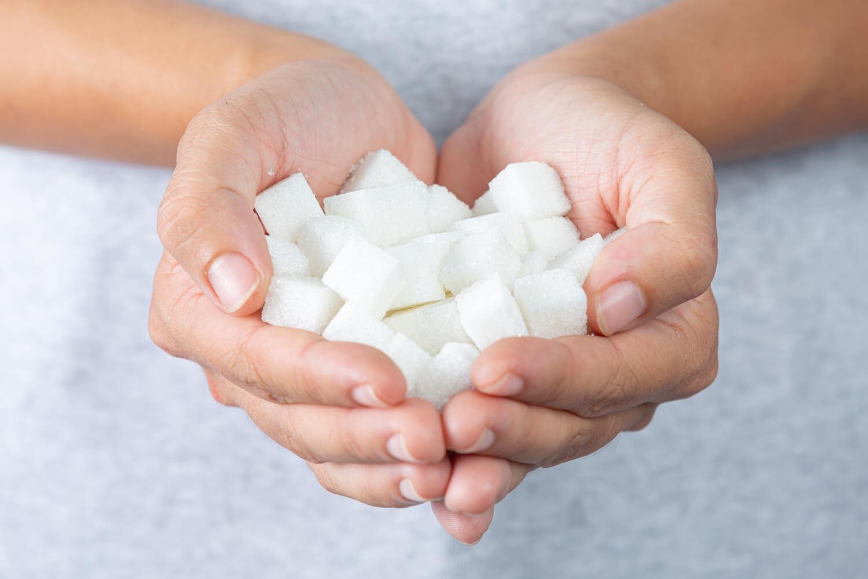 world-diabetes-day-hand-holding-sugar-cubes