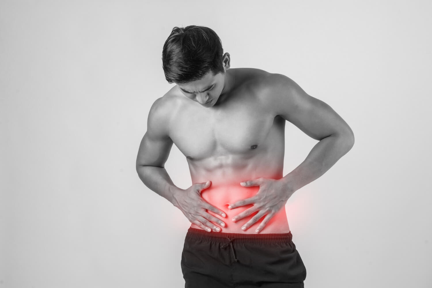 young-handsome-muscular-man-has-abdominal-pain-isolated-white-background
